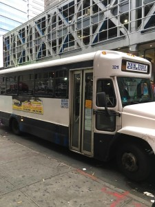 Bergenline jitney, operated by Fuji Express, about to board on 42nd street